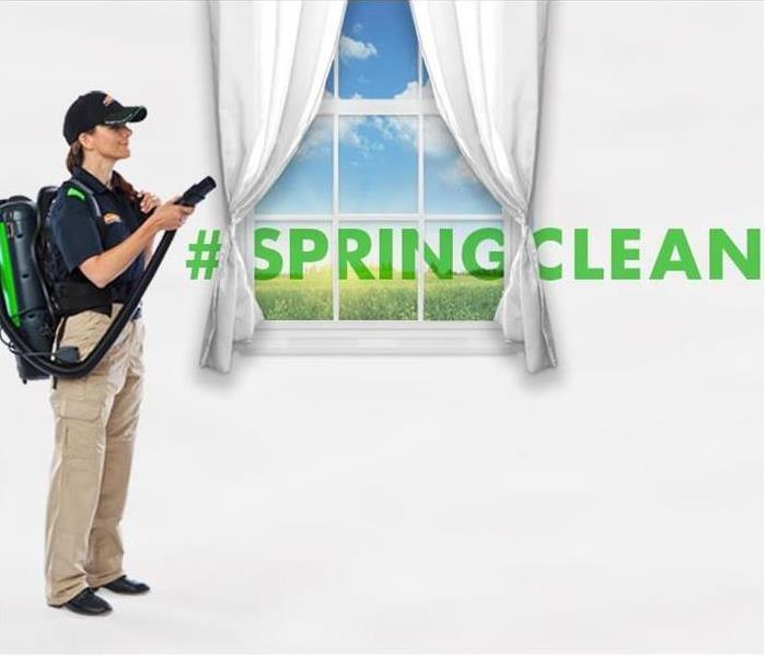 SERVPRO technician cleaning customer